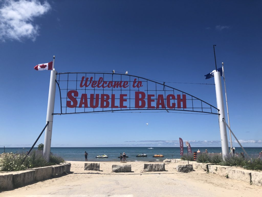 A sign welcomes visitors to Sauble Beach, Ontario.