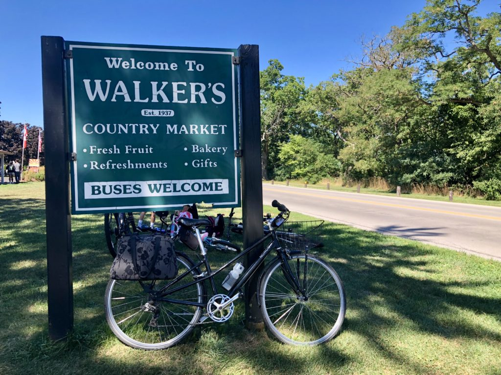 Bicycle with roadside sign for Walker's Country Market near Niagara on the Lake, Ontario