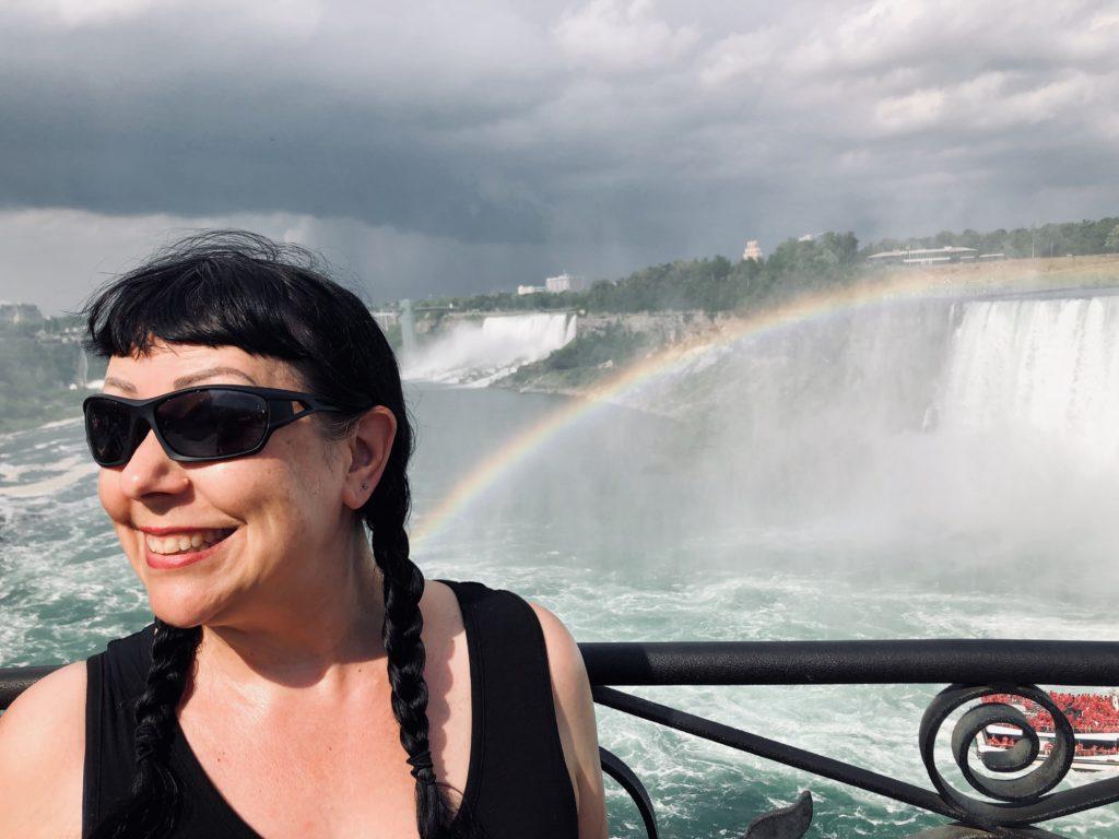 Woman with rainbow at Niagara Falls, Ontario Canada