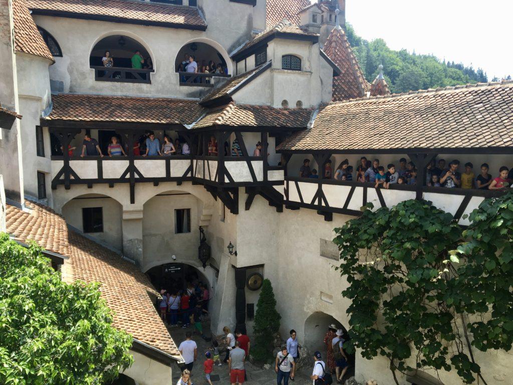 Visitors crowd inside Bran Castle in Romania