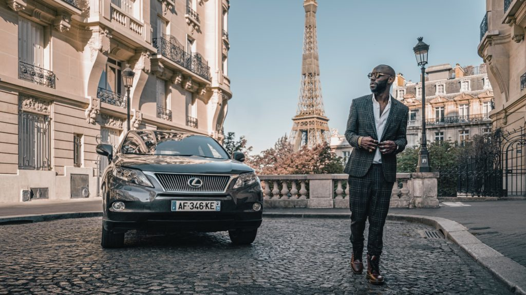 Man and car in the streets of Paris.