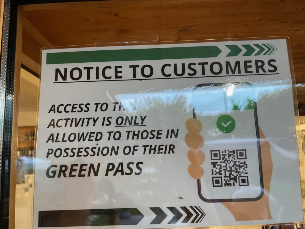 Green Pass sign seen in restaurant when travelling to Italy from Canada
